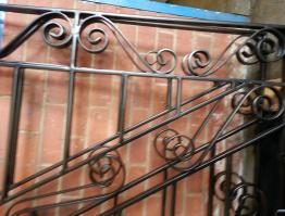 Refurbished matt black gates
